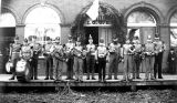 The Silverton Trombone Band standing in front of the I.O.O.F. Hall in Silverton, Oregon, 1887
