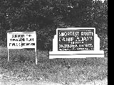 Two signs at the junction of the Independence-Dallas Road, 1942