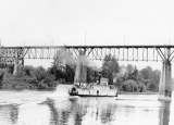 Sternwheeler passing under railroad bridge at Wilsonville, Oregon